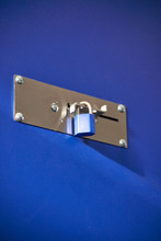 Blue Padlocks Locking A Blue Storage Door