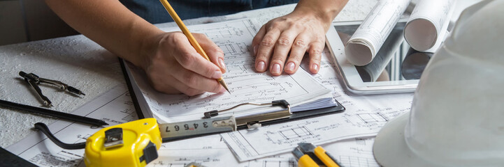 Architects concept, engineer architect designer freelance work on start-up project drawing, construction plan. architect design working drawing sketch plans blueprints and making construction model