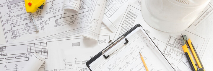 architect design working drawing sketch plans blueprints and making architectural construction model in architect studio,flat lay