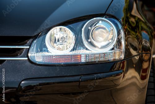 Obraz Car headlight with shallow depth of field. - fototapety do salonu