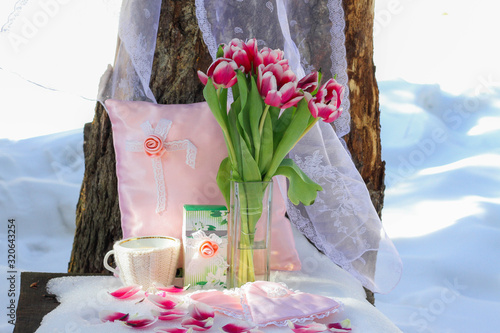 romantic still life, pink tulips in a vase, spring is coming, ice and fire, tulips in the snow, waiting for spring