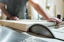 Caucasian Man Carpenter Cutting Wood With Circular Saw Creating New Furniture