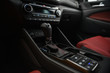 Interior of a car. Cup holders and automatic gearbx shifter.