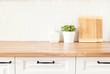 Leinwandbild Motiv Bright And Clean Kitchen With White Cabinets, Close Up. Cutting Boards, Green Succulent Pot On A Wooden Worktop. Kitchenware In Modern Kitchen Interior. White Tiles Background