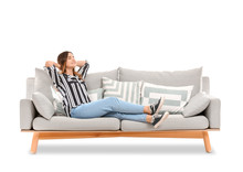 Young Woman Relaxing On Sofa A...