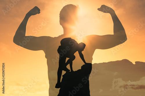 Fotografía Man climbing up mountain, feeling strong and powerful