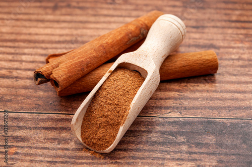 Taste enhancing and flavour spice concept with wooden scoop with fine powder and Canvas Print