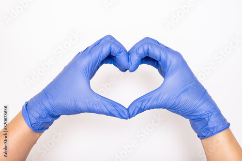 Fototapeta Heart made of latex, nitrile medical gloves for doctor and nurse protection on w