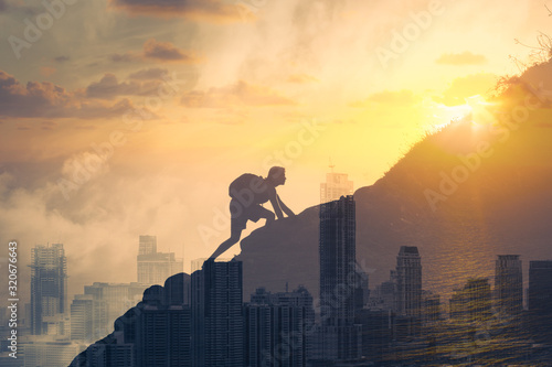 Fototapeta People achieving goals, determination and taking risk concept Man climbing up a mountain.  obraz