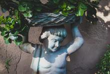 Statue In Garden