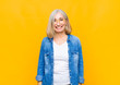 canvas print picture - senior or middle age pretty woman with a big, friendly, carefree smile, looking positive, relaxed and happy, chilling