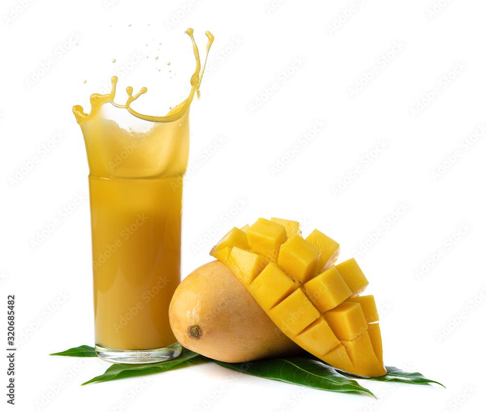 Fototapeta Mango juice splash in a glass with mango slice isolated on white background.