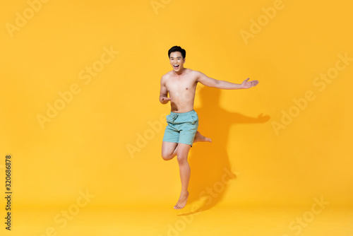 Fototapety, obrazy: Energetic smiling shirtless handsome Asian man jumping