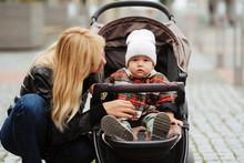Stylish Blonde Mother Walking ...