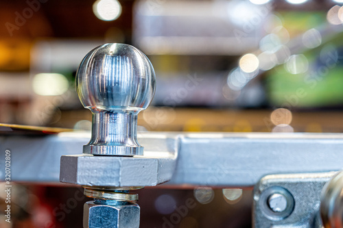 Fototapeta New and shiny trailer hitch or towbar at car accessories store