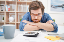 Young Troubled Guy Calculating Bills Tax Expenses And Counting Home Business