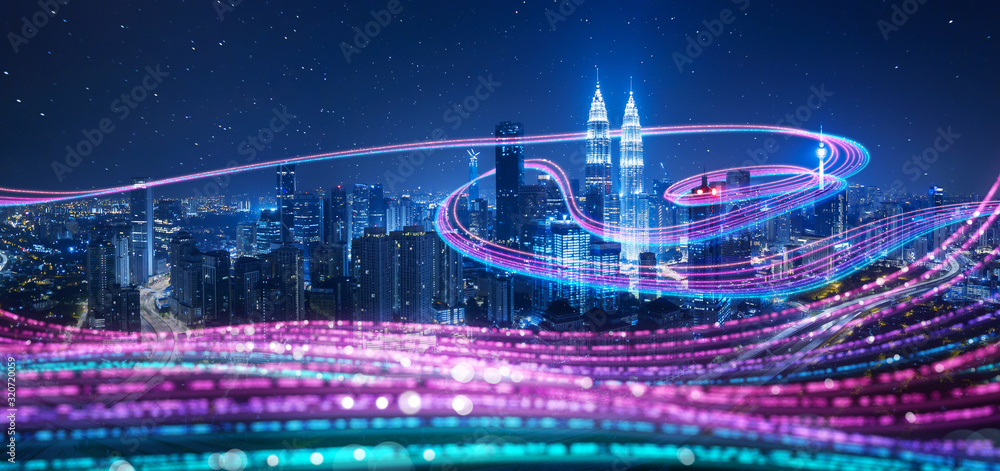 Fototapeta Night city with abstract gradient blue and red glowing light trail surround the city ,Smart city big data connection technology concept .