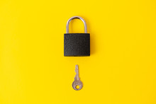 Lock And Key On Yellow Backgro...