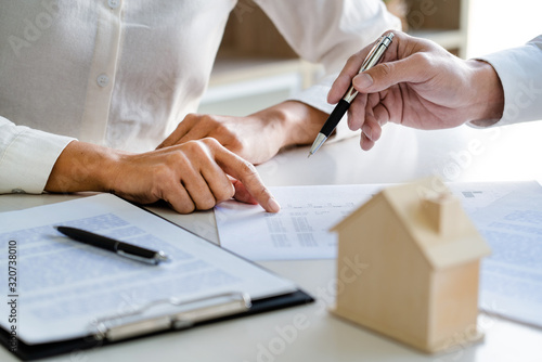 Real Estate Agent broker or House developer showing contract for buying house agreement to consultant employee Wallpaper Mural