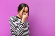 Leinwanddruck Bild - young pretty woman feeling stressed, unhappy and frustrated, touching forehead and suffering migraine of severe headache against purple wall