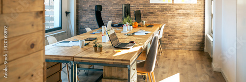 Obraz Interior of industrial style coworking office with various workplaces - fototapety do salonu