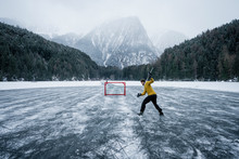 Ice Hockey Player Shoots And S...