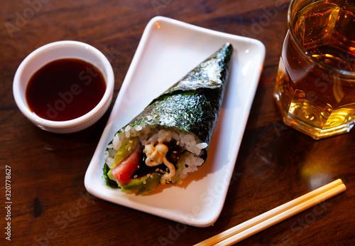 Fototapeta Rolled temaki sushi. Traditional japanese cuisine obraz