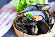 Mussels With Herbs Lemon On Cook Steamer Food Background - Fresh Seafood Shellfish In The Restaurant Mussel Shell Food On Bamboo Steamer