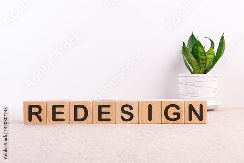 Fotografie, Obraz REDESIGN word made with building blocks on light background
