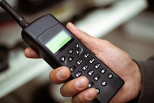 Male Hand Holds A Black Plastic Vintage Cell Or Radio Phone