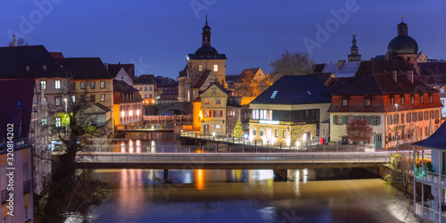 Obraz Aerial panoramic view of Old town hall or Altes Rathaus with bridges over the Regnitz river at night in Bamberg, Bavaria, Upper Franconia, Germany - fototapety do salonu