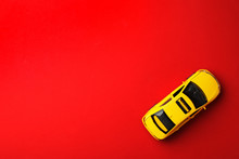 Yellow Taxi Car Model On Red B...