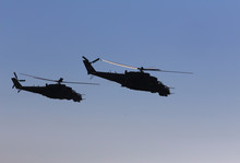 Military Helicopters Fly In Th...