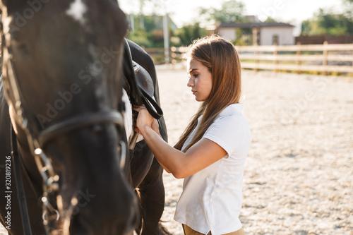 Fototapeta Beautiful woman with horse in countryside obraz
