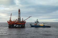 Icebreaker Alongside An Oil Rig In The Arctic At Kara Sea Russia.