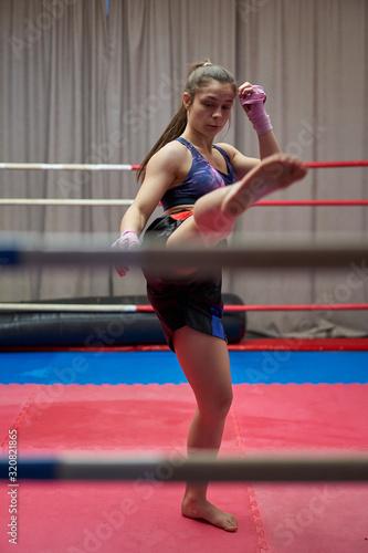 Female kickboxer shadow boxing Wallpaper Mural