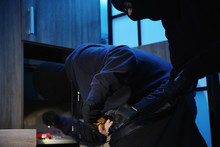Thieves Taking Gold Bars Out Of Steel Safe Indoors At Night