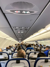 Cabin Of A Modern Airplane Filled With Passangers To Its Full Capacity During Flight, After Delayed Departure (shallow DOF)
