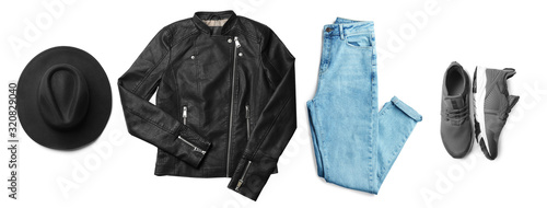 Stylish outfit with black leather jacket on white background