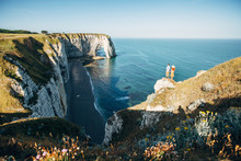 Couple Looking At Etretat Clif...