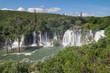 Beautiful view of Kravica waterfalls after heavy rains. Large tufa cascade on Trebizat River, in karstic heartland of Herzegovina. Lush surrounding and rich riparian ecosystem. Bosnia and Herzegovina