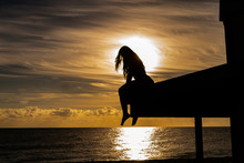 Silhouette Of Young Woman On S...