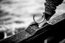 Hand On Wooden Boat, Black And...