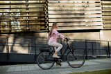 Young woman riding e bike in urban enviroment