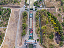 Cargo Transportation By Water Of Petrochemical Equipment In Russia. The Cargo Train Of Tugs Passes The First Lock Of The Volga-Don Navigation Canal In Volgograd. Russia