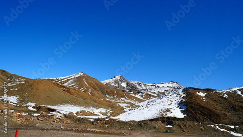 Bright landscape of Morocco, breathtaking curves of mountains, stunning combination of hills & farm land,inadvertent distribution of houses & huts, raw impression of pure nature. #320865477
