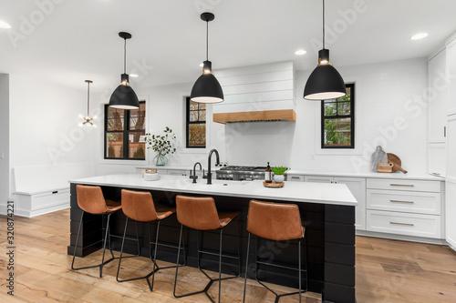 Fototapeta Beautiful white kitchen with dark accents in new modern farmhouse style luxury home obraz