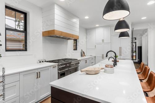 Obraz Beautiful white kitchen with dark accents in new modern farmhouse style luxury home - fototapety do salonu