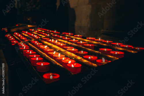 Candles lit in the church a spiritual and calm mood in the church Canvas Print
