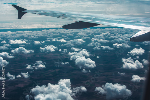 View from the plane window in flight to clouds and sky Wallpaper Mural